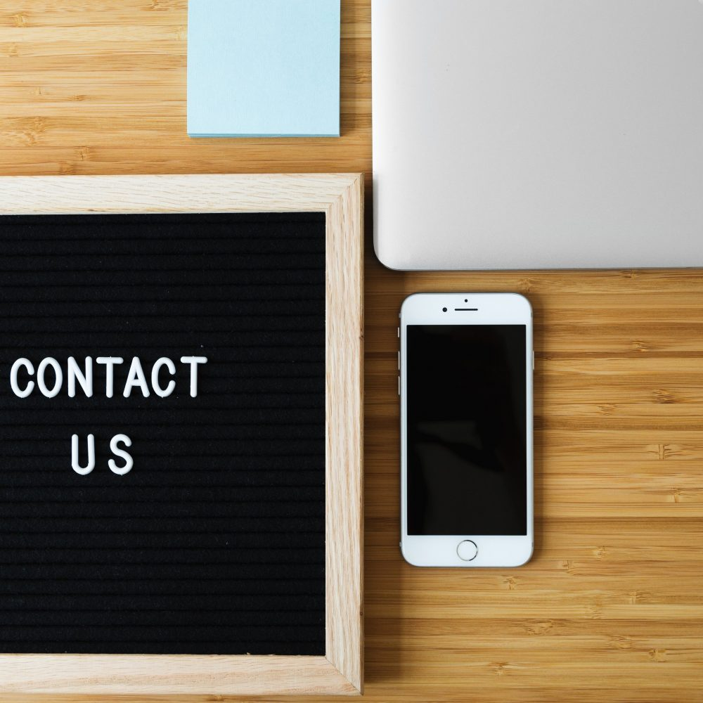 contact-us-sign-with-phone-on-desk_4460x4460